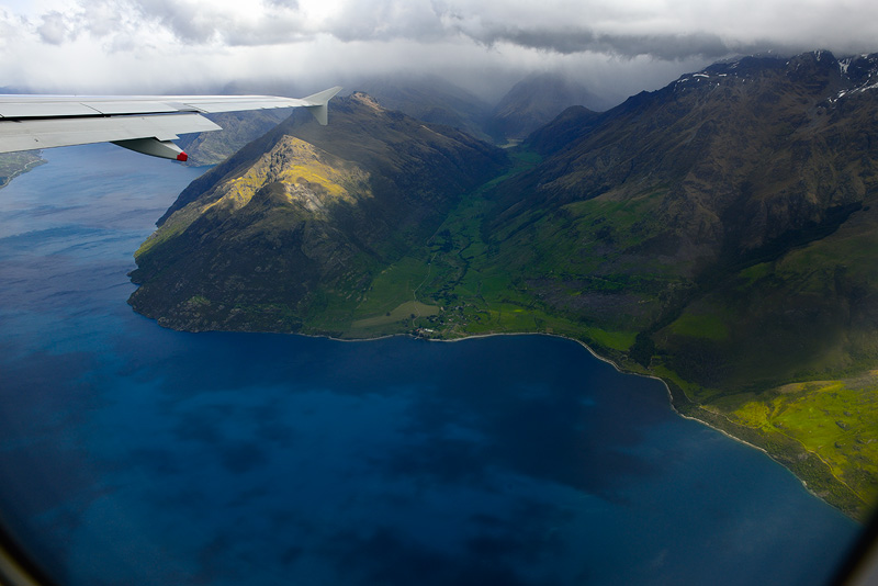 Aerial airplane view of Lake Wakatipu departing Queenstown New Zealand