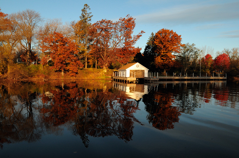 Boat Dock and fall foliage sunrise reflection