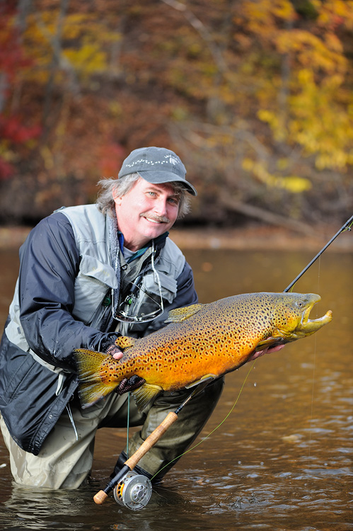 Graham Owen with a huge orange colored brown trout